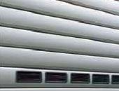 Рулонные ворота Hormann с вентиляционными решетками.